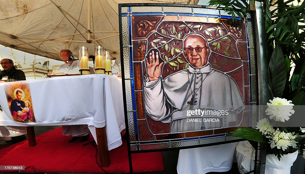 A stained glass with an image of Pope Francis is seen on an altar outside the Sanctuary of Saint Cayetano -- Argentina's patron saint of bread and work -- in Liniers, a neighbourhood in western Buenos Aires on August 7, 2013 where thousands of faithfuls gathered to listen a prerecorded message of Pope Francis. Before becoming Pope and when he was archbishop of Buenos Aires, cardinal Jorge Bergoglio officiated the central mass at the sanctuary on Saint Cayetano feast day.