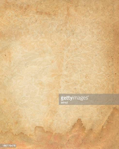 stained paper with faded floral pattern