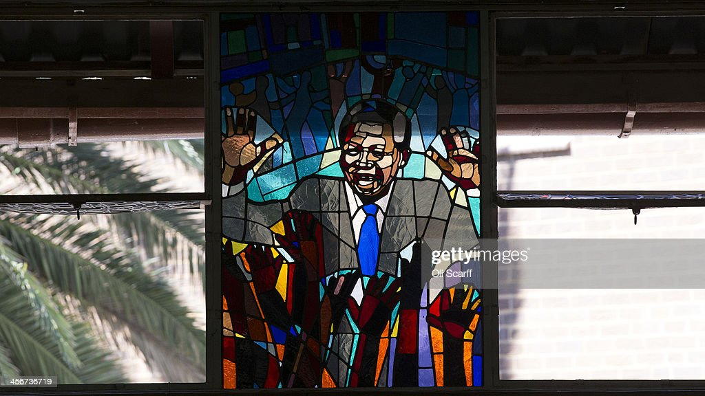 A stained-glass tribute to Nelson Mandela in Regina Mundi Catholic Church in Soweto Township as the funeral of the former South African President takes place in Qunu on December 15, 2013 in Soweto, South Africa. Mr Mandela passed away on the evening of December 5, 2013 at his home in Houghton at the age of 95. Mandela became South Africa's first black president in 1994 after spending 27 years in jail for his activism against apartheid in a racially-divided South Africa.
