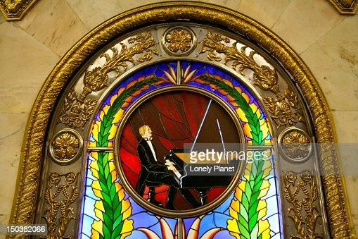 Stained-glass window depicting pianist in Novoslobodskaya Metro Station. : Stock Photo