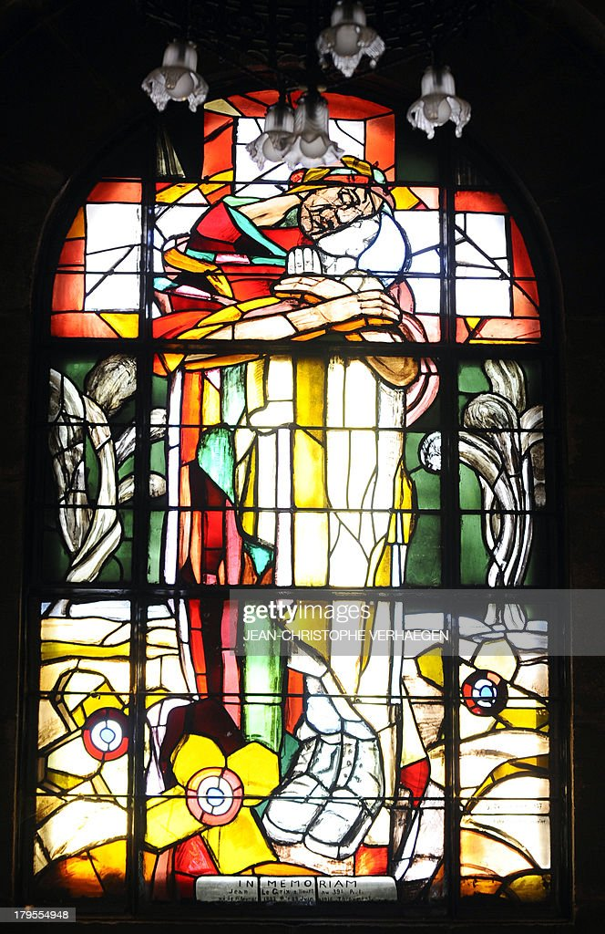 A stained-glass window in the chapel of the ossuary of Douaumont is pictured on September 3, 2013 in Douaumont, eastern France. The ossuary is a memorial containing the remains of at least 130,000 unidentified French and German soldiers who died on the Verdun battlefield during World War I. Built from 1885 to 1913, Fort Douaumont is the largest and highest fort on the ring of 19 large defensive forts which protected the city of Verdun during World War I.