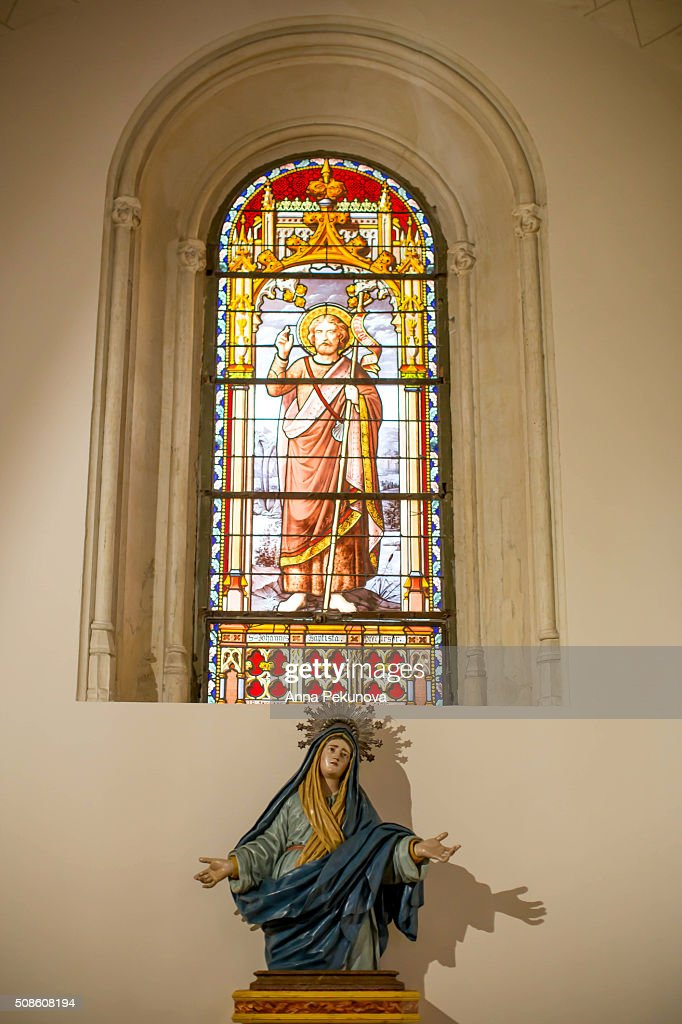 Stained-glass windows and statues inside St. Jerome the Royal Church, Madrid : Stock Photo