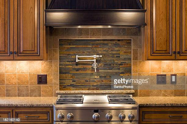Stainless Residential Kitchen Range with Pot Faucet, Tile & Cabinets