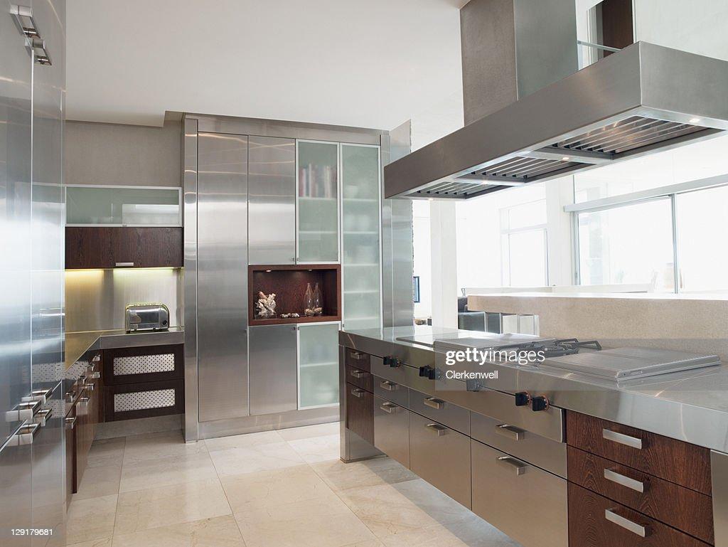 Stainless Steel Kitchen In Luxury Apartment Stock Photo