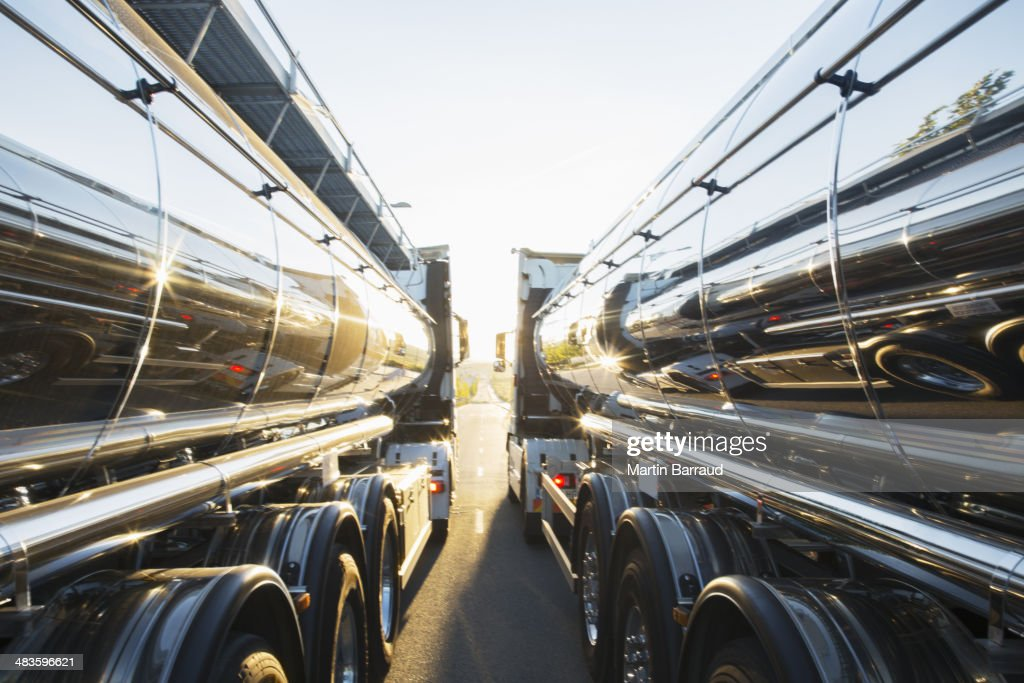 Stainless steel milk tankers side by side