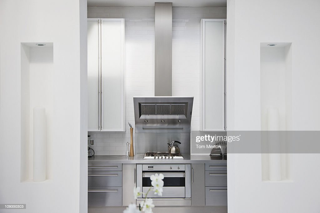 Stainless steel stove in modern white kitchen : Stock Photo