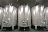 Stainless steel vats on industrial wine cellar