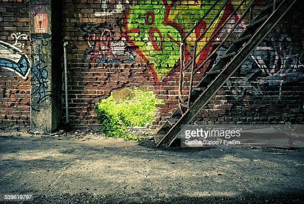 Staircase Against Graffiti On Brick Wall