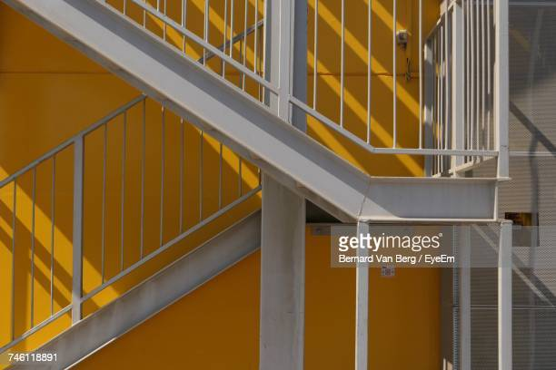 Staircase By Orange Wall