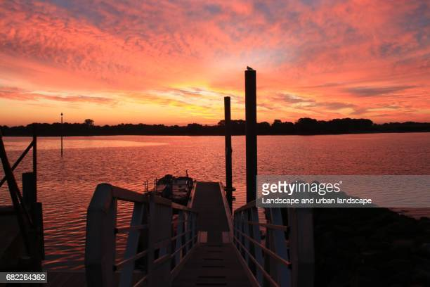 Staircase in a harbor at sunrise