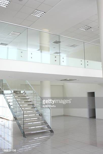 A staircase in an empty white modern architectural home