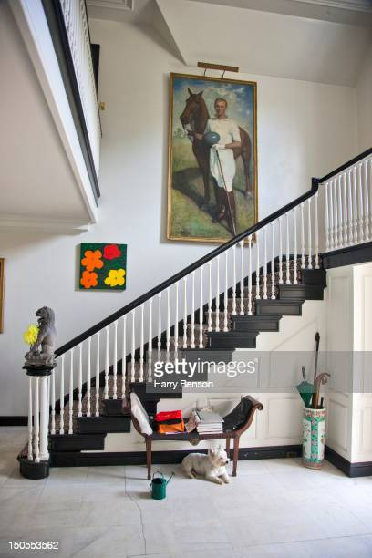 Staircase in Templeton Cornelia Guest's family home with a painting of her father polo player Winston Guest in Old Westbury NY in September 2011