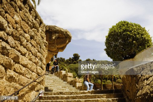 Staircases along a stone wall, Parc Guell, Barcelona, Spain : Stock Photo