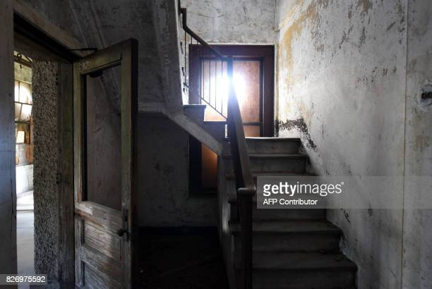 Stairs are seen in a room in one of the buildings of the The Ellis Island Hospital on August 5 a 750bed facility which treated over 12 million...
