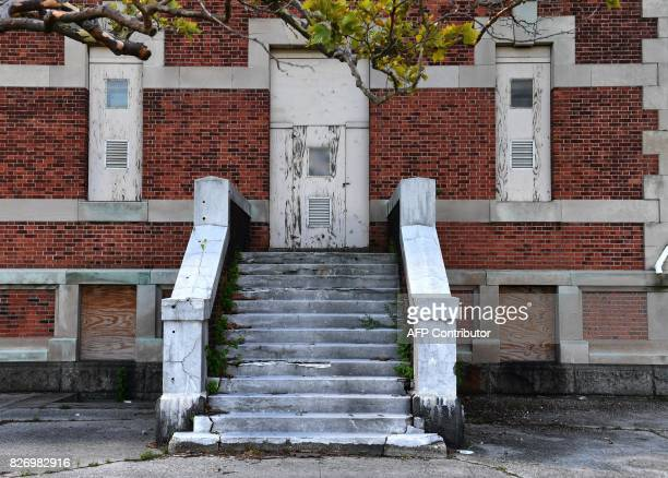 Stairs are seen outside one of the buildings of the The Ellis Island Hospital on August 5 a 750bed facility which treated over 12 million patients...