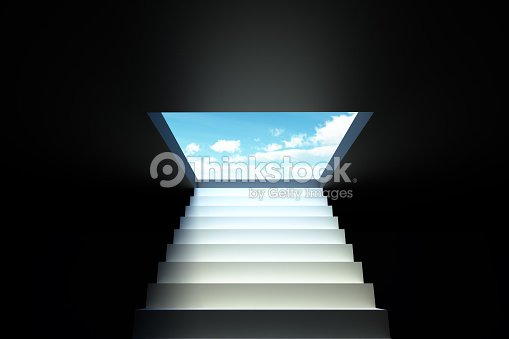 Stairs leading from the darkness to the blue sky : Stock Photo