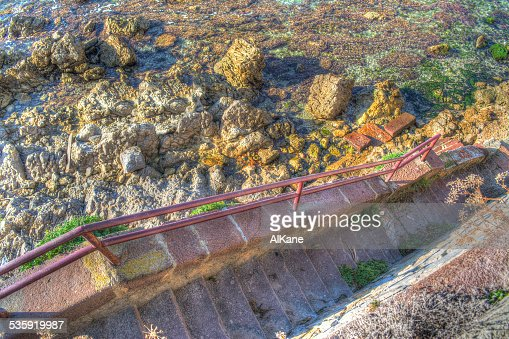 stairs to the rocky shore : Stock Photo