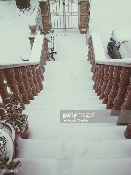 Stairway leading towards gate in winter