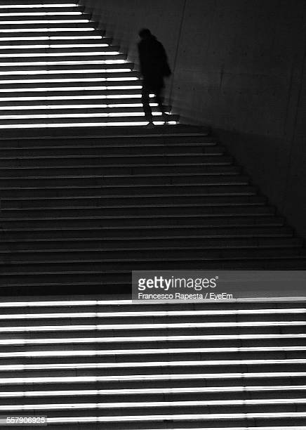 Stairway With Silhouette Of Person Walking Up