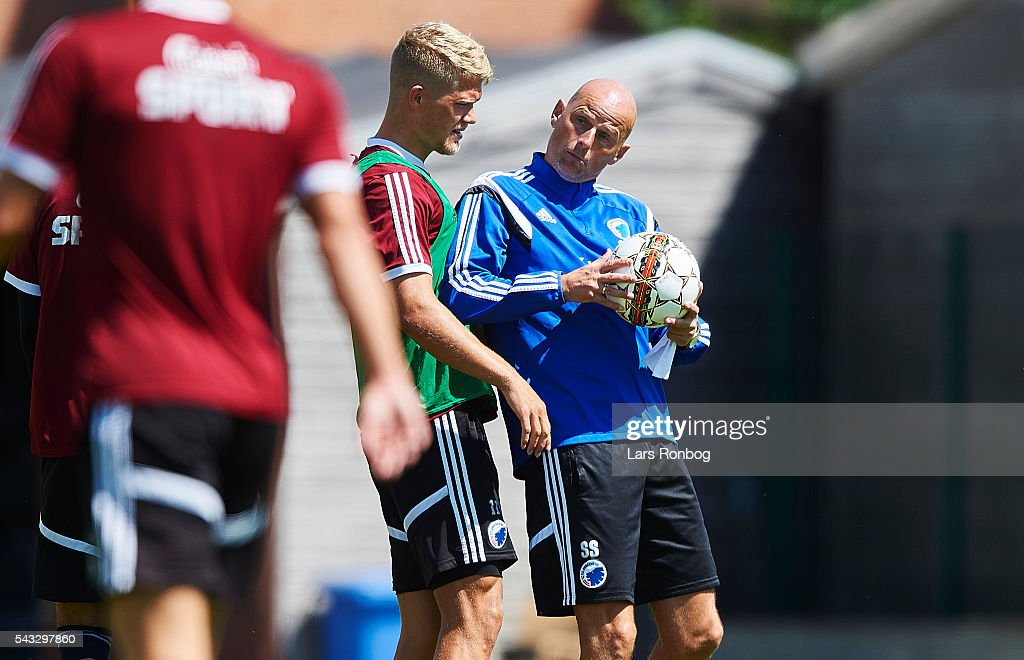 <a gi-track='captionPersonalityLinkClicked' href=/galleries/search?phrase=Stale+Solbakken&family=editorial&specificpeople=2726325 ng-click='$event.stopPropagation()'>Stale Solbakken</a>, head coach of FC Copenhagen in action with <a gi-track='captionPersonalityLinkClicked' href=/galleries/search?phrase=Andreas+Cornelius&family=editorial&specificpeople=8617821 ng-click='$event.stopPropagation()'>Andreas Cornelius</a> of FC Copenhagen during the FC Copenhagen training session at KB's baner on June 27, 2016 in Frederiksberg, Denmark.