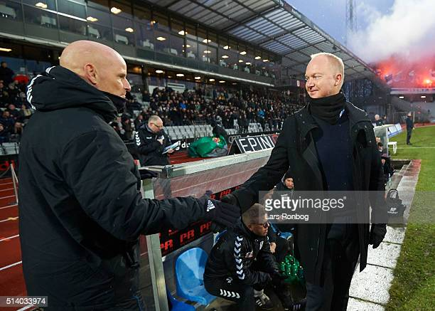 Stale Solbakken head coach of FC Copenhagen shake hands with Glen Riddersholm head coach of AGF Aarhus prior to the Danish Alka Superliga match...