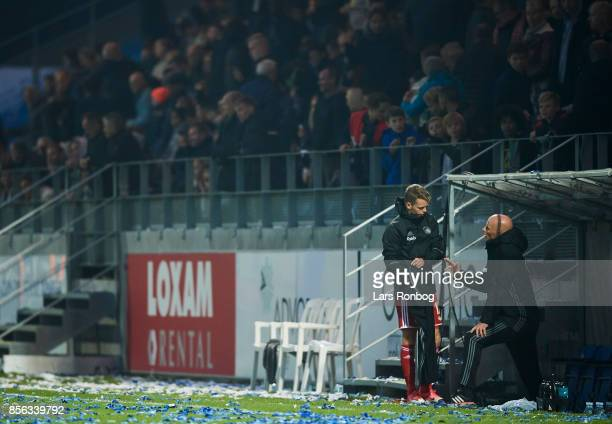 Stale Solbakken head coach of FC Copenhagen speaks to Kasper Kusk of FC Copenhagen during halftime in the Danish Alka Superliga match between Lyngby...