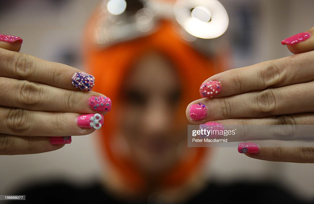 A stall holder at The Hyper Japan event at Earls Court shows off her painted fingernails on November 23, 2012 in London, England. The show is the UK's biggest Japanese Culture event, with stalls selling clothing and artwork. live music, Japanese food and computer gaming areas are also on show. Many attendees dress up as anime characters or in the lolita fashion widespread in Japan.