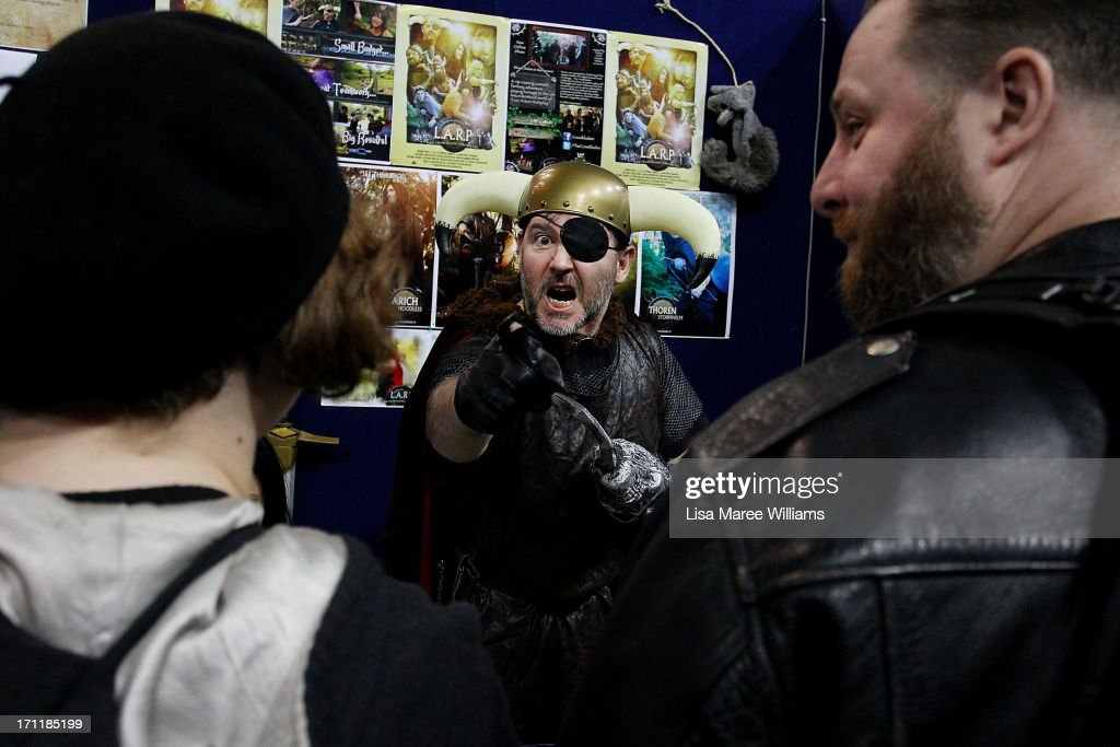 A stall holder entertains the crowd during the 2013 Supanova pop culture festival at Sydney Showground on June 23, 2013 in Sydney, Australia.