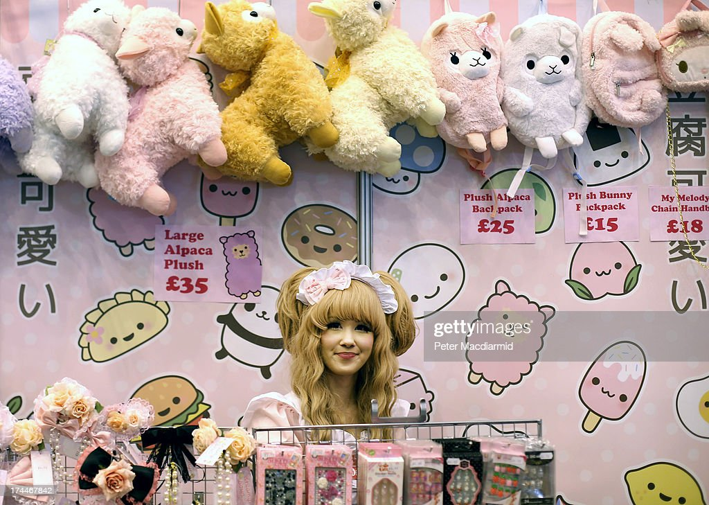 A stall holder in costume waits for customers at the Hyper Japan event at Earls Court on July 26, 2013 in London, England. The show is the UK's biggest Japanese Culture event, with stalls selling clothing and artwork. Live music, Japanese food and computer gaming areas are also on show. Many attendees dress up as anime characters or in the lolita fashion widespread in Japan.