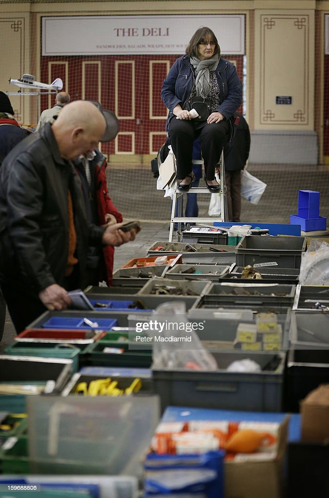 A stall holder keeps an eye on customers from a on top of a step ladder at The London Model Engineering Exhibition at Alexandra Palace on January 18, 2013 in London, England. The exhibition features more than a thousand models from over 50 national and regional clubs and societies. A wide range of locomotives, boats and aircraft are on show.