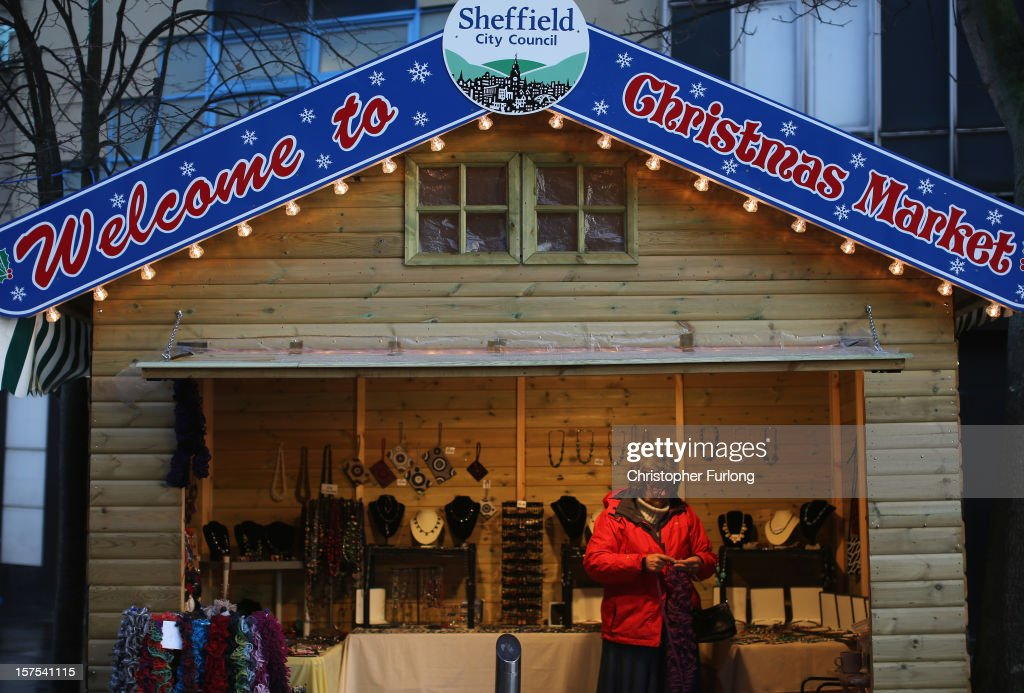 A stall holder knits scarves as she waits for customers at Sheffield's Christmas Market on December 4, 2012 in Sheffield, United Kingdom. Retailers across Britain are struggling as people wait for bigger discounts before spending for the Christmas period. The British Retail Consortium (BRC) said that it's members were in a 'state of nervousness' in the last weeks of the festive period.