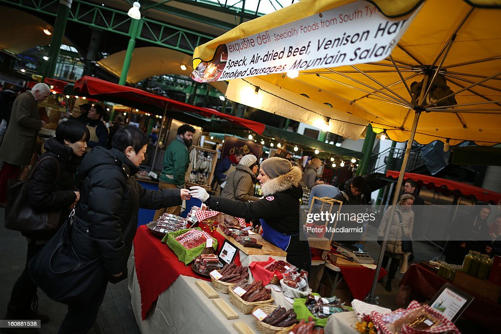 A stall holder makes a sale at Borough Market on February 7, 2013 in London, England. Borough Market, London's oldest since 1756, has recently completed renovation and today had it's first day of full trading.