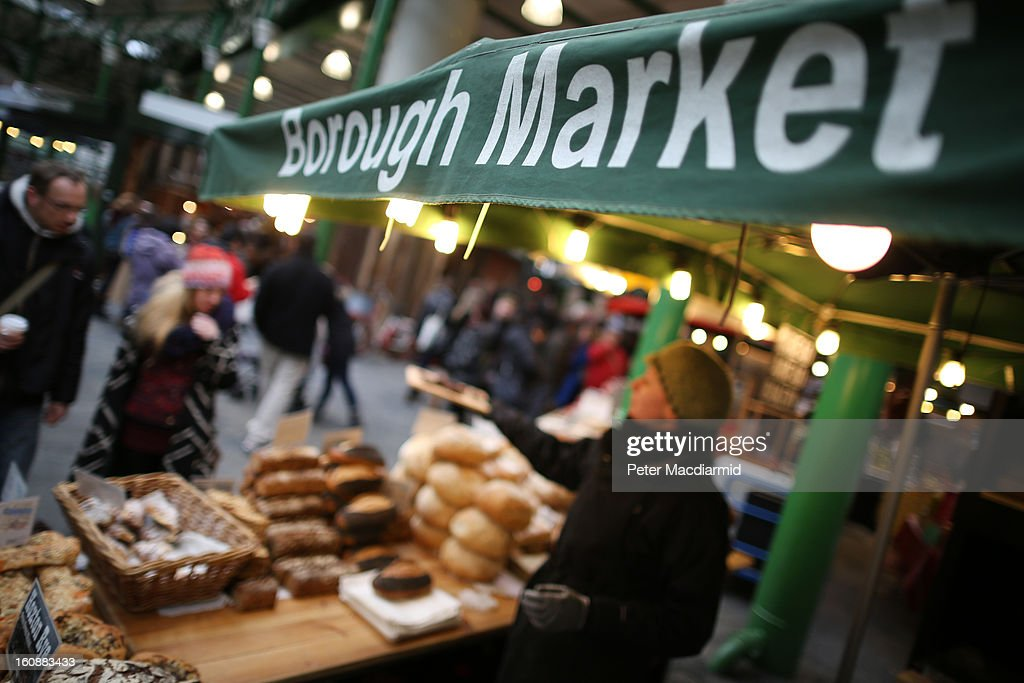 A stall holder offers a free sample to customers at Borough Market on February 7, 2013 in London, England. Borough Market, London's oldest since 1756, has recently completed renovation and today had it's first day of full trading.