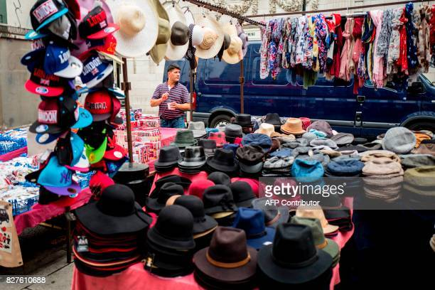 A stall holder preapres hats on his stall at Portobello Road Market in the Notting Hill district of west London on August 8 2017 Last week The Bank...