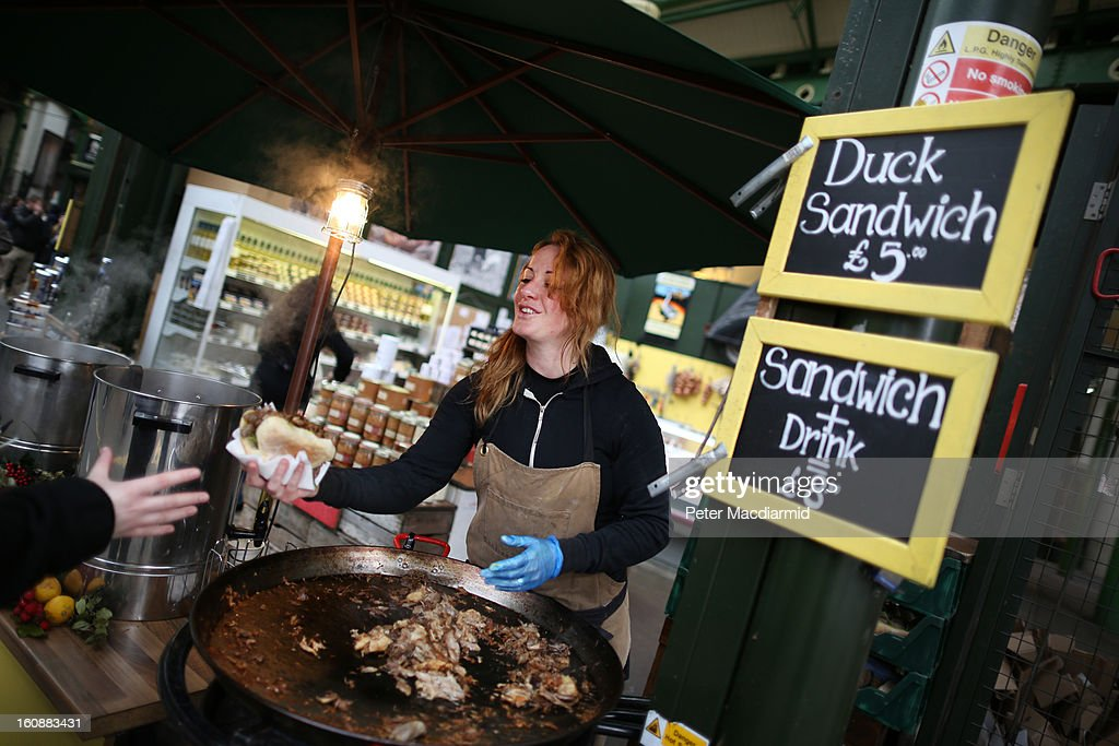 A stall holder sells a duck sandwich at Borough Market on February 7, 2013 in London, England. Borough Market, London's oldest since 1756, has recently completed renovation and today had it's first day of full trading.
