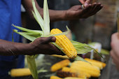 A stall holder sells sweet corn during the Notting Hill Carnival on August 24 2014 in London England The Notting Hill Carnival is the largest street...