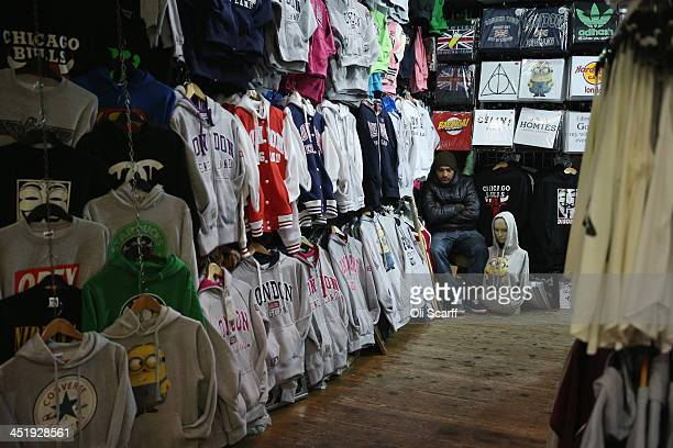 A stall holder sits in his shop in Camden Market on November 25 2013 in London England The proposed route of the HS2 high speed rail link is due to...