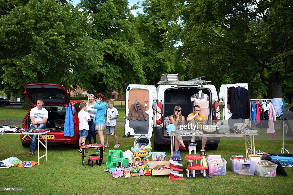 Stall holders wait for customers at a car boot sale in the village of St Boswells in Scotland close to the border between England and Scotland on June 26, 2016. Scotland's First Minister Nicola Sturgeon campaigned strongly for Britain to remain in the EU, but the vote to leave has given the Scottish National Party leader a fresh shot at securing independence. Sturgeon predicted more than a year ago that a British vote to leave the alliance would give pro-European Scots cause to hold a second referendum on breaking with the UK. SCARFF