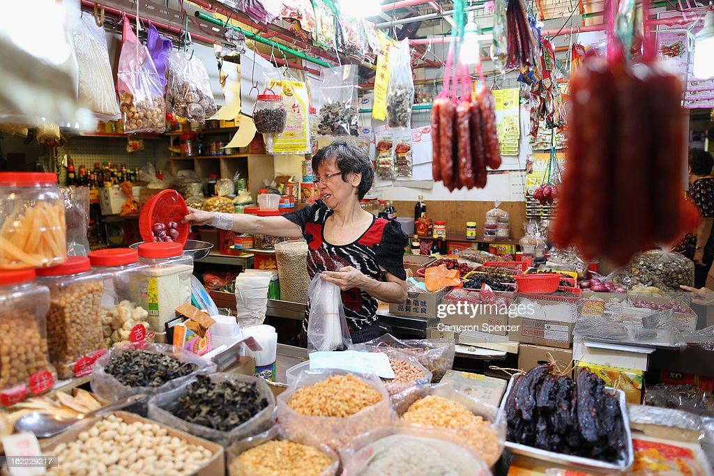 A stall keeper sells local delecacies at the Singapore Chinatown Complex Wet Market on February 21, 2013 in Singapore. The Chinatown Complex Wet Market is a traditional Asian food market popular with elder Singaporeans that features fresh seafood, meat, vegetables, Chinese groceries and a variety of exotic delicacies. The bustling complex floors are never dry with melting ice and water used to clean the floors, fish and vegetables spilling through the space, thus earning the name 'Wet Market'. The markets have retained their relevance by guaranteeing freshness and a personal service between stall mongers and loyal customers.