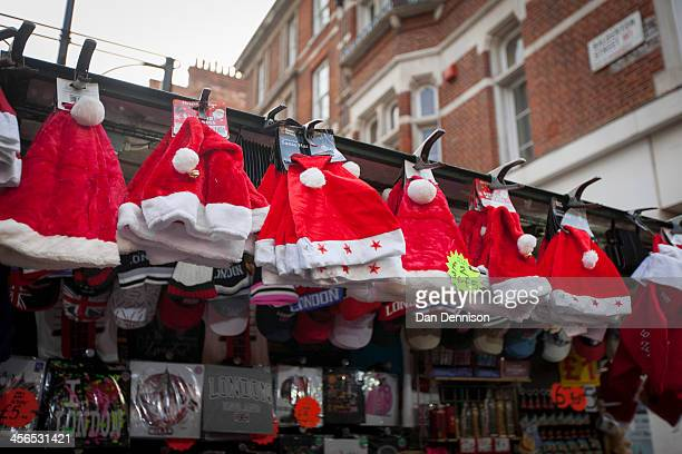 A stall on Oxford Street selling a wide range of Santa Claus hats on December 14 2013 in London England As Christmas Day approaches London's central...