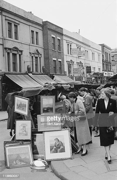 A stall selling art on Portobello Road Market London 1955
