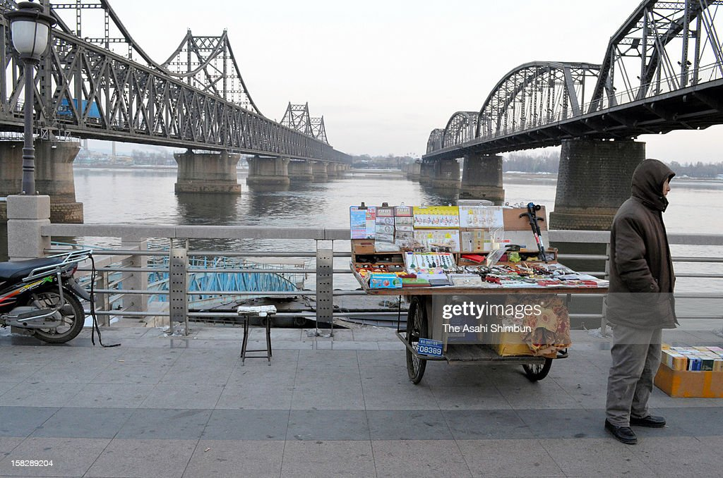 A stall selling North Korea related souvenirs is open as usual at the China-North Korea border city on December 12, 2012 in Dandong, China. North Korea launched a long range missile on 9:49am local time, believed to drop off into the Pacific Ocean off the Phillipines.