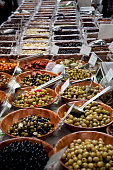 Stall selling olives and nuts in Leadenhall Market in the City of London Located in Gracechurch Street the market dates back to the fourteenth...