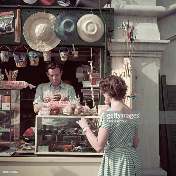 A stall selling summer paraphernalia in SouthendonSea Essex circa 1955 The candyfloss is marked 'Festival Gardens London'
