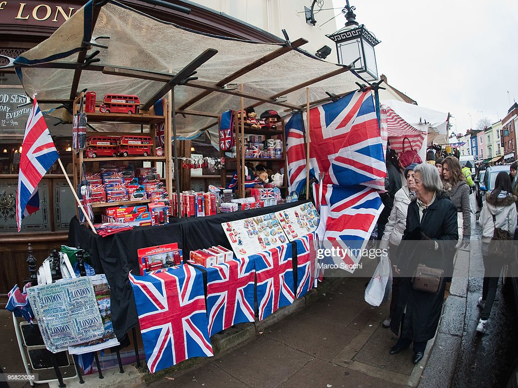 A stall sells British souvenirs at Portobello market on January 16, 2010 in London, England. Portobello traders fear for the Market's future after Lipka's Antiques Arcade, where more than 150 traders had their stalls, was redeveloped to accommodate a large High street chain store.