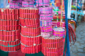 Stall on the street with stacks of different collections of fireworks.