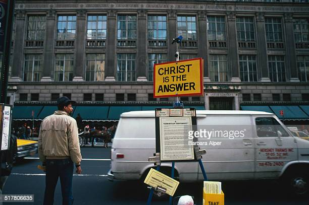 A stall with religious leaflets opposite Saks Fifth Avenue on 5th Avenue New York City December 1986