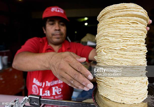 A stallholder weighs traditional corn tortillas in Mexico Cty on June 18 2008 Mexican president Felipe Caldern announced an agreement with...