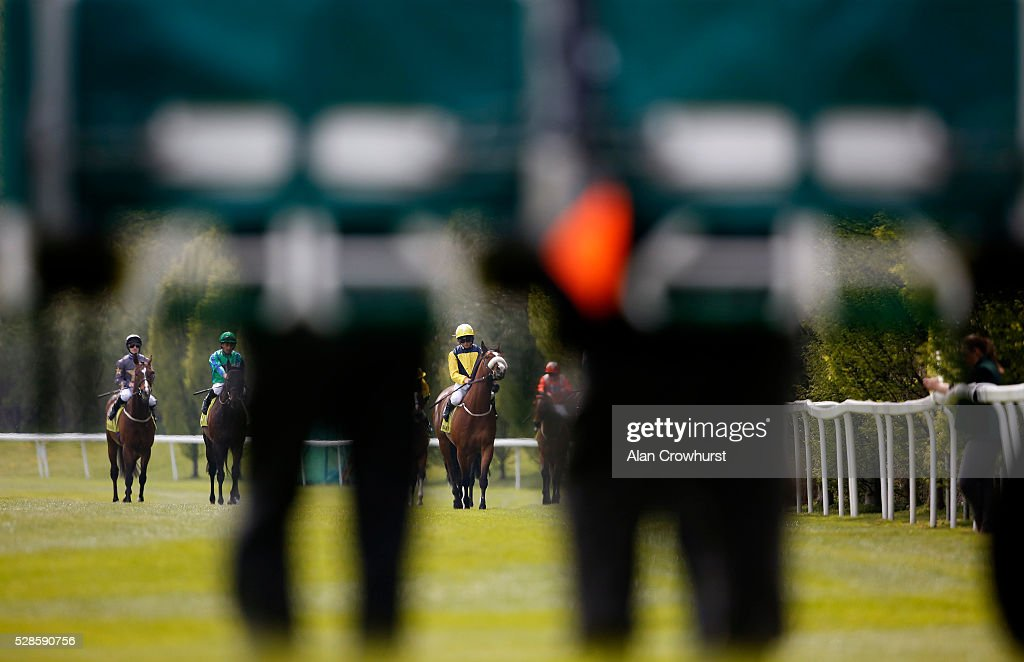 Stalls handlers wait as the runners approach at Chester racecourse on May 6, 2016 in Chester, England.
