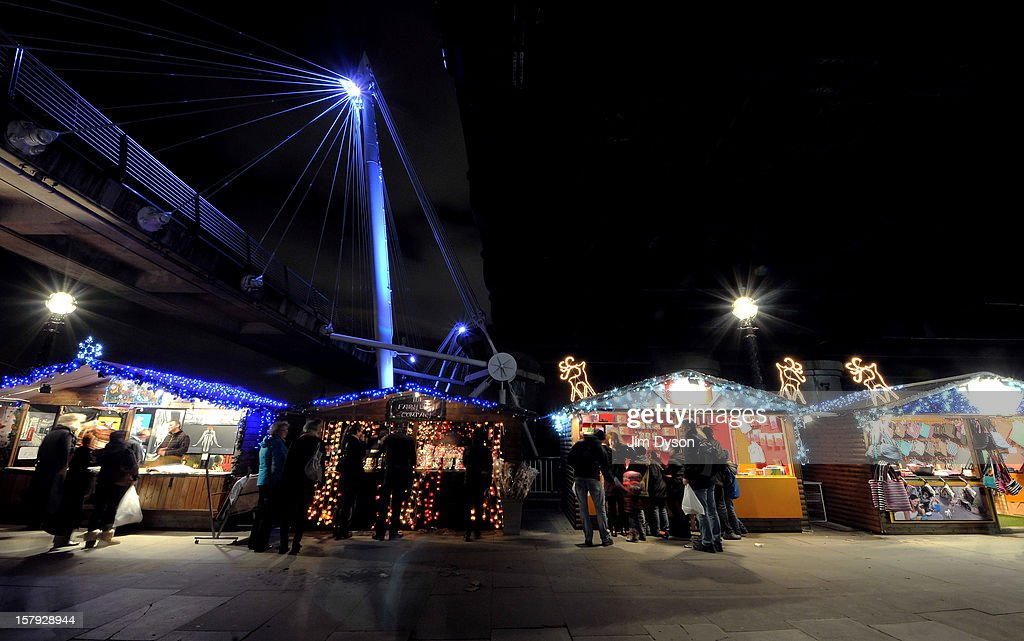 Stalls sell festive wares to shoppers at a christmas market on the South Bank on December 7, 2012 in London, England. Eighty authentically decorated wooden chalets make up the Southbank Centre German Christmas Market as part of the Southbank's Winter Festival.